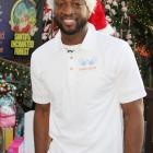 Wade puts on his Santa hat while hosting a holiday event for kids at Santa's Enchanted Forest in Miami.
