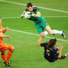 Carles Puyol of Spain collides with his goalkeeper Iker Casillas Iker during their 1-0 win over the Netherlands.
