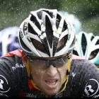 Lance Armstrong rides under the rain on July 5 in the 201 km and second stage of the Tour de France.