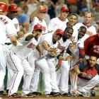 Teammates wait to congratulate Ryan Zimmerman after he hit the game winning homer in the ninth inning against the San Diego Padres on July 6 in Washington, D.C.