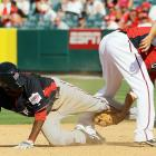 U.S. Futures All-Star Danny Espinosa of the Washington Nationals tags out World Futures All-Star Eury Perez of the Washington Nationals during the 2010 XM All-Star Futures Game on July 11 in Anaheim.