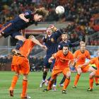 Spain's Carles Puyol jumps for a header over Netherlands' defender John Heitinga during the 2010 World Cup final at Soccer City stadium. Spain defeated the Netherlands 1-0 for its first World Cup title.