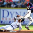 Austin Jackson of the Detroit Tigers steals second as Orlando Hudson of the Minnesota Twins loses the ball on July 9 at Comerica Park. The Tigers won 7-3.