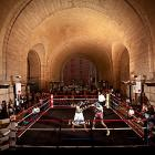 """Amateur boxers spar under the archway at Dumbo Fight Night, held in Brooklyn (under the Manhattan Bridge) on July 14. The event was sponsored by Gleason's Gym. The Underpass was closed for 17 years before reopening in 2008, trying to bring business into the """"DUMBO"""" district."""