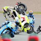 Spain's Ducati rider Aleix Espargaro (left) and France's Honda driver Randy De Puniet (right) crash during the Moto Grand Prix of Germany on July 18.