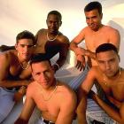 Alex Rodriguez, Derek Jeter, and Edgar Renteria and friends were all linked together by more than their chains for this photo shoot: they were part of a wave of talented young shortstops to reach the majors in the late 1990s.