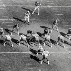 In an I-formation, Cowboys quarterback Roger Staubach prepares to take a snap in an October game against the Giants. Dallas used a fourth-quarter touchdown to capture an important 13-7 victory.