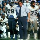 With tackles Art Shell (left) and John Vella at his side, Raiders coach John Madden watched his offense go to work in a 31-20 victory over the Colts on Sept. 28. Oakland came back from an early 10-point deficit to win.
