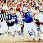 Baltimore Colts quarterback Bert Jones scrambles away from pressure against the Dolphins. The Colts defeated the Dolphins twice in the 1975 season.