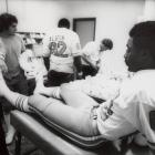 """Billy """"White Shoes"""" Johnson gets his shoes taped before the Oilers' game against the Raiders. Johnson had three receptions for 37 yards."""