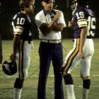 """For the Minnesota Vikings, this huddle included one Hall of Fame head coach (Bud Grant), one Hall of Fame quarterback (Fran Tarkenton, left) and one """"General,"""" backup quarterback Bob Lee."""