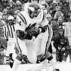 Vikings quarterback Fran Tarkenton hands the ball off to running back Chuck Foreman. While Foreman would become the first Viking to rush for 1,000 yards in a single season, Tarkenton was named the NFL's MVP in 1975.