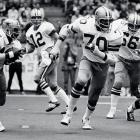 Cowboys tackle Rayfield Wright led the way for Robert Newhouse during a 31-10 win over the Redskins.