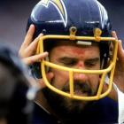 Chargers quarterback Dan Fouts takes off his helmet during the Chargers 40-34 overtime win against the L.A. Raiders.
