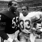 Tony Dorsett of the Cowboys talks to linebacker Otis Wilson of the Bears after Chicago's 44-0 drubbing of the Cowboys at Texas Stadium.