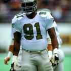 "After being taken in the 1st round of the 1984 supplemental draft, ""The Minister of Defense"" burst onto the NFL scene in 1985 with a 13-sack rookie season for the Philadelphia Eagles. He wore No. 91 that first season because Smiley Creswell was wearing No. 92. Smiley wasn't on the '86 team and Reggie went back to No. 92. White played eight seasons in Philadelphia before adding his name to a lawsuit against the NFL that resulted in NFL players being granted free agency in 1992. He moved to Green Bay for the 1993 seasons and won Superbowl XXXII in 1997."