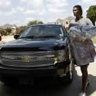 Bosh (and his dry cleaning) arrives at his home in DeSoto, Texas.