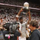 Bosh holds the Eastern Conference Trophy after the Heat eliminated the Celtics on Saturday. Bosh missed the first four games of the series but sparked Miami off the bench in Game 7 with 19 points and eight rebounds.