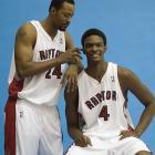 Morris Peterson jokes around with Bosh during team photos in Toronto.