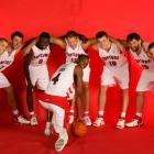 Bosh poses with Anthony Parker (18), Andrea Bargnani (7), Pape Sow (9), Rasho Nesterovic (12), Uros Slokar (10), Jorge Garbajosa (15), and Jose Calderon (8) before a preseason game against the Celtics.