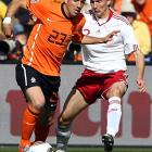 Van der Vaart (left) is exceptionally gifted but has failed to distinguish himself in games where he replaced Arjen Robben. The Dutch attack has looked far more lively when Eljero Elia and not van der Vaart plays out on the left wing.