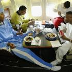 Carmelo Anthony, Rodney White, Earl Boykins and Andre Miller eat while the Denver Nuggets fly to Orlando for a game against the Magic.