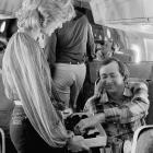 Yankees relief pitcher Goose Gossage samples a chocolate offered by Bucky Dent's wife, Stormie during the team's jet flight to New York.