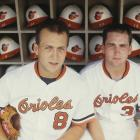 Ripken poses with his brother, Billy, in the Orioles dugout. In 1987, the Ripken family made baseball history when Cal Sr. managed his sons in Baltimore, marking the first (and only) time a father managed two sons simultaneously in the majors.