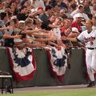 Ripken celebrates with Baltimore fans after breaking Lou Gehrig's 56-year-old record for most consecutive games played. Ripken's streak would come to an end in 1998 at 2.632 games.