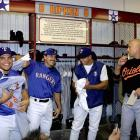 Texas' Ivan Rodriguez, Rafael Palmeiro and Alex Rodriguez jokingly remove jerseys from Ripken's locker during a ceremony to retire the shortstop's locker at the Ballpark in Arlington.