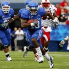 """The multitalented Cobb had 1,673 all-purpose yards in '09; he ranked third in the SEC in punt returns (12.8 yards per attempt) and would have ranked fifth in kickoff returns (26.5) but did not have enough chances. Cobb also starred at wide receiver and played QB in Kentucky's """"WildCobb"""" formation."""