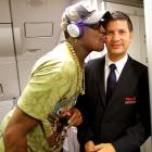"""Are the Miami Heat recruiting """"The Worm""""?  Something had Dennis Rodman flying high as he boarded a flight from Miami to Madrid."""