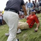 """Is that my ball or are you just glad to see me?"" Lefty appears to be asking after his drive landed in the lap of a fan near the 11th hole at Whistling Straits during the PGA Championship. The fan's voice was reportedly several octaves higher after Mickelson clumsily employed a sand wedge to blast the ball out of the difficult lie."