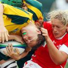 Gemma Hallett of Wales tried her level best to separate Australia's Rebecca Trethowan from her noggin and, presumably, the ball as the ladies scuffled it out at Surrey Sports Park in Guildford, England.
