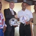In 1990, Smith was drafted with the 17th overall pick by Dallas and had immediate success, rushing for 937 yards and 11 touchdowns his rookie season. Along with Troy Aikman and Michael Irvin, Smith helped Dallas reclaim its status as one of the NFL's elite teams. Here Smith poses with Aikman, Moon and Givins at a press conference to promote the Cowboys-Oilers game at Tokyo Dome.