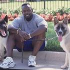 Smith relaxes at home with his two dogs.