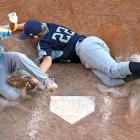 Ezre Heleski of Waipahu, Hawaii, slides home safely on the final play of the game as Jaron Roblyer of Pearland, Texas, is unable to make the tag on Aug. 28 in South Willamsport, Pennsylvania. Waipahu won the United States Championship 10-0 but lost to Japan in the finals.