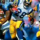 """A key cog of the Rams' """"Greatest Show On Turf,"""" Faulk played his last game in 2005, ending a career in which he produced 19,154 combined yards from scrimmage. His 6,875 yards receiving are the most by any running back.  Runner-up: Darrell Green  Worthy of consideration: Warrick Dunn, Abner Haynes, Chris Johnson. Curtis Martin, Adrian Peterson, Ahmad Rashad, Curt Warner, Darren Woodson"""
