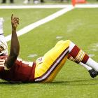Robert Griffin III took little time to live up to the hype that surrounded him as he entered the NFL. Even before he did that, he gave birth to a trademark celebration that spread virally among RGIII fans. After throwing the first touchdown pass of his pro career, Griffin, sitting up on the Superdome turf after getting knocked down on the play, pointed with both hands of outstretched arms. The pose caught fire, as did the quarterback, who won Offensive Rookie of the Year.