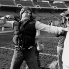"Houston Oilers quarterback Dan Pastorini ( pictured, left ) scuffled more than once with the  Houston Post 's Dale Robertson, including an instance at the team's practice facility in 1980 when Pastorini shoved Robertson through a door in reaction to an article in that morning's newspaper. Robertson landed at the feet of coach Bum Phillips ( pictured, right ), who at that moment was telling reporters that the Oilers had never had any issues with the media. Phillips then added, ""Until now."""