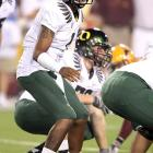 Darron Thomas threw for two touchdowns and ran for another, and No. 5 Oregon unleashed a big-play passing offense to pull away from Arizona State in the Pac-10 opener for both teams. Arizona State held the nation's second-leading rushing team to 145 yards - 235 below its average -  but the Sun Devils committed seven costly turnovers in the loss.