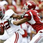 Alabama proved itself mortal against Arkansas, but the No. 1 Tide rallied from a 13-point second-half deficit for a 24-20 win. Mark Ingram ran for 157 yards and the game-winning score, a one-yard TD run with 3:18 to play. The Tide were able to run out the clock after intercepting Arkansas QB Ryan Mallett for the third time.