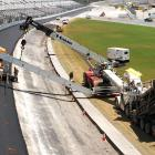 Since July 5, the day after the Coke Zero 400, Daytona International Speedway has been undergoing a repave. Originally scheduled for 2012, the project was moved up two years after a pothole marred February's Daytona 500.  The job presents a number of challenges, the biggest being the 31-degree banked surface, which requires specially made equipment, including bulldozers outside the crash walls connected to the paver.