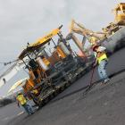 The project includes replacing the surface on the entire tri-oval, the apron and runoff areas. The area is 1.4 million square feet, and requires an estimated 50,000 tons of asphalt, which is being produced at a plant behind the backstretch.  While it is the policy of International Speedway Corporation, which owns DIS, to not disclose project price tags, one construction insider estimates it is in excess of $15 million.