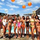 OK, I count six balloons, four of them orange at this shot from the Maxim Magazine Hometown Hotties competition. Did you come up with the same number?