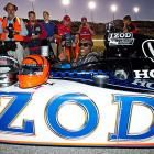 "The newest member of the Cincinnati Bengal's gets set to go for ride in the ""IZOD Fastest Seat in Sport"" driven by two-time Indy 500 winner Arie Luyendyk during the pace laps at Saturday night's Kentucky Indy 300."