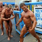 To readers of the female persuasion who clamor for more photos of manly men to counterbalance our gratuitous weekly flood of scantily-clad women, we present these big slabs of beefcake at the annual bodybuilding and bikini competition at Venice Beach, Calif.