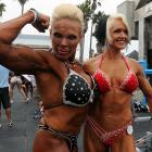 To readers who are fixing to complain about the preceding two photos, we present Lauren Powers and Maire Brandon at the annual bodybuilding and bikini competition at Venice Beach. Jump ugly with us and we'll have Ms. Powers readjust your attitude.