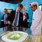 """Chief FIFA inspector Harold Mayne-Nicholls (center) pondered a proposed venue (actual size, according to our sources) in Doha, Qatar.   """"You appear to be under the impression that soccer's fan base is shrinking rather dramatically,"""" Mayne-Nicholls supposedly grumbled to Technical Director Jasir Al-Jamal (right) of the Aspire sports complex."""