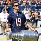 The captain of the Stanley Cup champion Blackhawks showed the NFL what a real trophy looks like before da Bears took on the Lions at Soldier Field in Chicago.